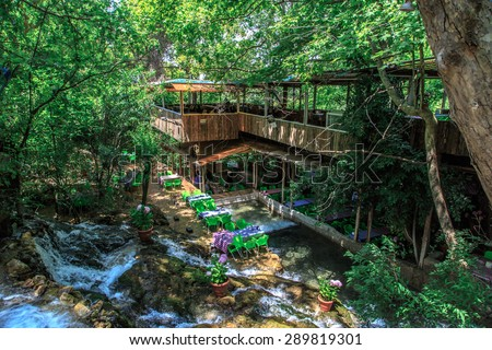 HATAY, TURKEY - JUNE 7, 2015 : Top view of restaurant with colourful table and chairs, settled in Harbiye Waterfall in Antakya. - stock photo