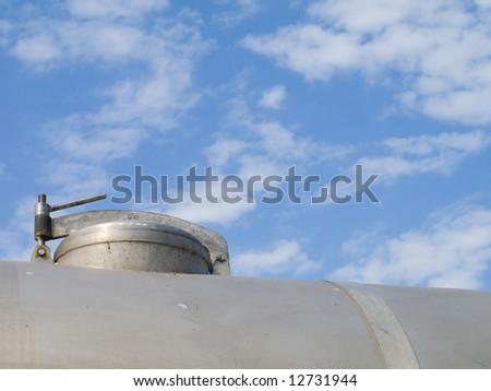 hatch of  cistern on  background of  sky - stock photo