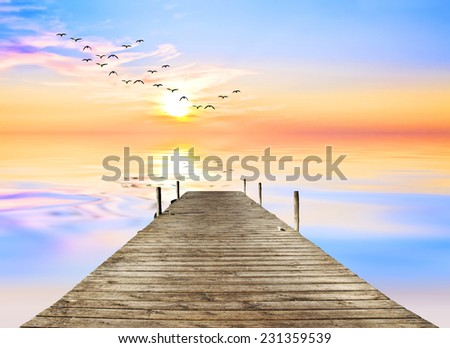 hatching colors on the calm ocean - stock photo
