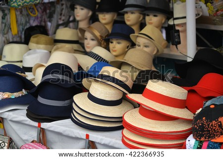 hats and headgear in the storefront - stock photo