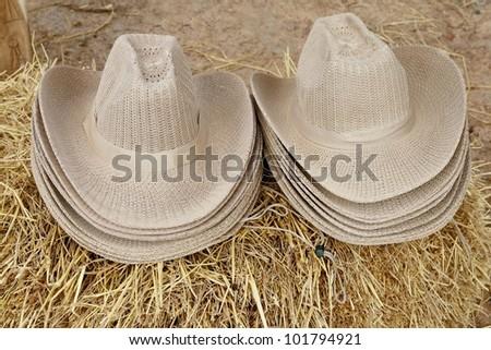 hats on straw - stock photo
