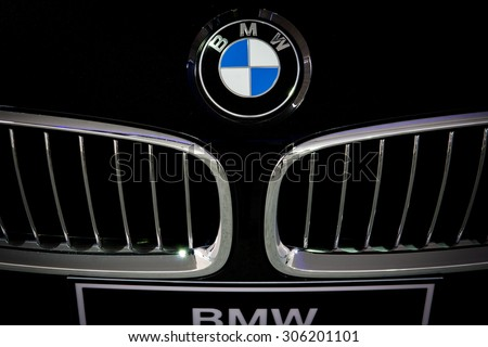 "HATYAI, THAILAND - AUGUST 9, 2015: Logo of the brand ""BMW"" on car - stock photo"