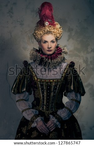 Haughty queen in royal dress