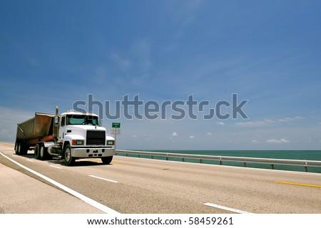 hauler truck crossing seven mile bridge in florida keys - stock photo