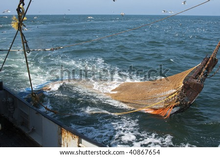 Hauling fishing nets on the North Sea - stock photo