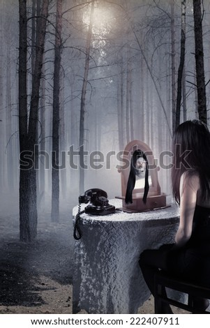 haunted girl in a terrible misty forest - stock photo