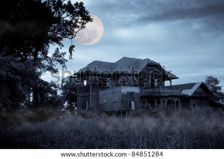 Haunted halloween house with full moon - stock photo