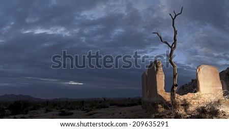Haunted Mansion Of Joshua Tree, front lit panorama, Joshua Tree National Park - stock photo