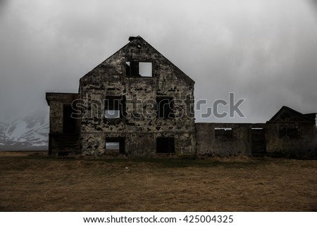 Haunted old house in Icelandic country side - stock photo