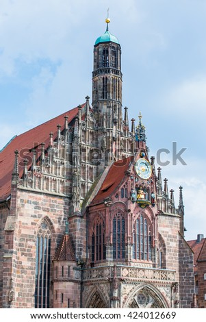 Hauptmarkt, the central square and Frauenkirche church of Nuremberg, Bavaria, Germany. The church is a brick gothic architecture built in the 14th century.