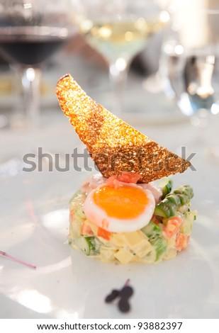 Haute cuisine appetizer on restaurant table - stock photo