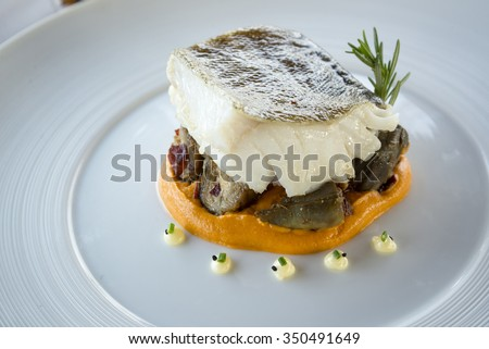 Haute cuisine fish dish - stock photo