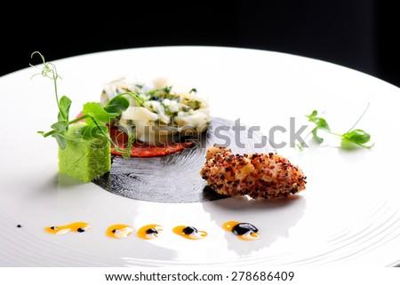 Haute cuisine, Gourmet appetizer, squid, shrimp tempura and Chorizo - stock photo