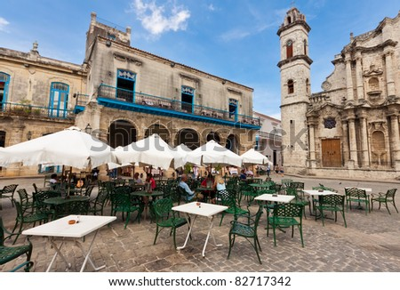 HAVANA-AUGUST 12:Tourists at a restaurant near the Havana Cathedral August 12,2011 in Havana.Tourism has become one of the main source of income for the country with over 2 million visitors a year - stock photo