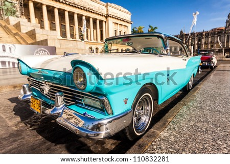 HAVANA-AUGUST 14:Vintage Ford Fairlane in front of the Capitol August 14,2012 in Havana.These old cars,the only ones that could be bought until last year,are a famous sight on the streets of the city - stock photo