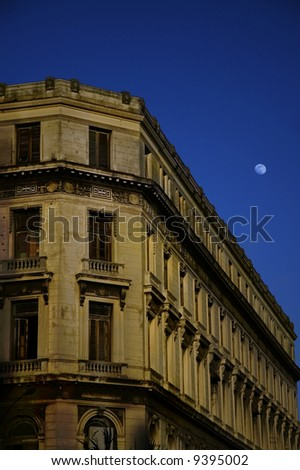 Havana building facade at dusk with early moon - stock photo
