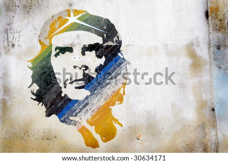 HAVANA - CIRCA DEC 2008: A grunge graffiti portrait of Che Guevara on a wall circa December 2008 in Havana, Cuba. After his death, Guevara is considered to be an iconic symbol of revolution worldwide. - stock photo