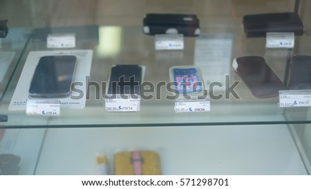 HAVANA CITY, CUBA - NOVEMBER 2016: Mobile phones and cards are displayed for sale in an ETECSA shop. ETECSA is a state-owned company which provide telephone, internet and wireless services in Cuba.