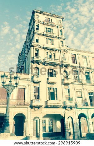 Havana Cuba aged photo effect reflects condition and style of colonial building in street scene  - stock photo