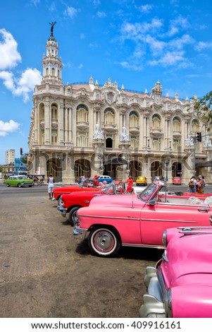 HAVANA,CUBA- APRIL 20,2016 :  Classic vintage cars next to the beautiful Great Theater of Havana on a clear sunny day - stock photo