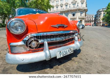 HAVANA,CUBA - APRIL 3, 2015 : Colorful vintage american car , a symbol of Old Havana - stock photo