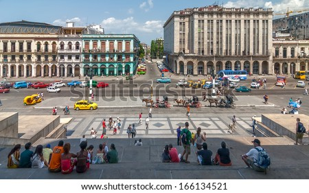 HAVANA, CUBA - APRIL 28: Explanada del Capitolio view from Capitolio with people sitting on stairs shown on 29 April 2008 in Havana, Cuba.  - stock photo