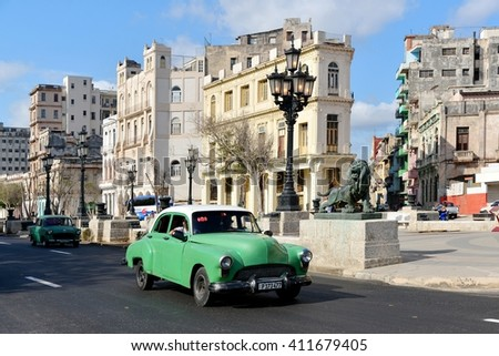 Havana, CUBA - APRIL 5, 2016: Havana old classic American car on street of Havana,CUBA. Cuba - Havana. Cuba cars in Havana. Cuba, Havana historic. Editorial photo. - stock photo