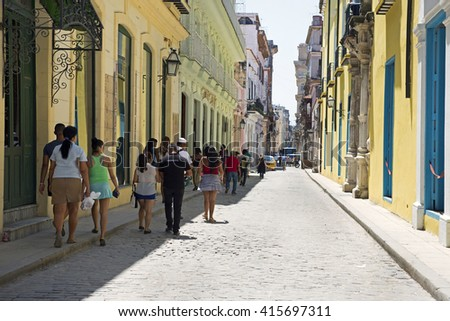 HAVANA, CUBA - APRIL 12, 2016: Main city of Cuba, Havana is attractive historic spot of this beautiful Carribean Island. Millions tourists visiting Cuba browsing in its colorful streets in old quarter - stock photo
