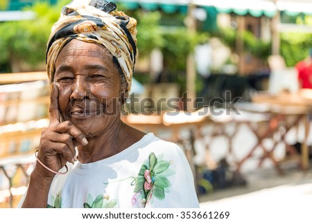 HAVANA,CUBA- AUGUST 9,2015: Cuban Afro Caribbean woman in Old Havana. People are friendly and an attraction for photographers.Old Havana is a Unesco World Heritage Site and a major tourist landmark - stock photo