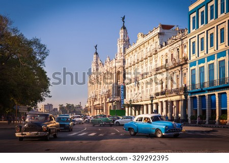 HAVANA, CUBA - CIRCA AUGUST, 2015: Central Square (Parque Central) with Inglaterra Hotel and The Great Theater of Havana on the left, Havana, Cuba. 50s cars drive through the street. - stock photo