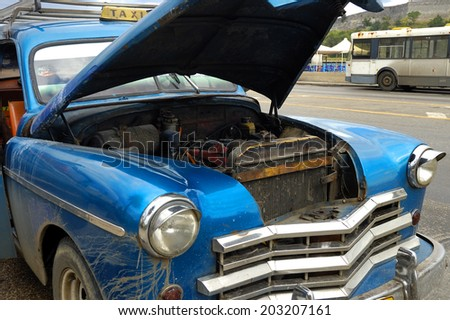 HAVANA, CUBA - DEC 3, 2008: Detail of vintage classic car commonly used as private taxi with opened trunk. - stock photo