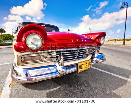 HAVANA, CUBA - DECEMBER 14: Classic Ford on December 14, 2011 in Havana, Cuba. Before a new law issued on October 1, Cubans could only trade old classic cars that were on the road before the revolution of 1959. - stock photo