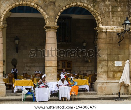 HAVANA, CUBA - DECEMBER 2, 2013: Old black ladys dressed in typical cuban clothes - stock photo