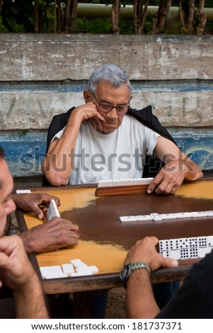 HAVANA, CUBA - DECEMBER 9, 2011: Quite common view in Havana, men playing Dominoes.