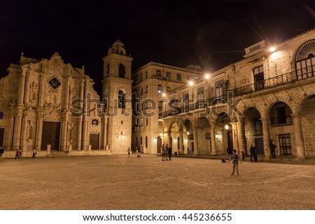 HAVANA, CUBA - FEB 20, 2016: Casa de Lombillo building and a cathedral on Plaza de la Catedral square in Habana Vieja. - stock photo