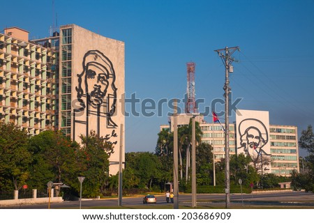 HAVANA, CUBA - FEB 6, 2011: Popular government building with Che Guevara and Camilo Cienfuegos image in front of Revolution square.  - stock photo