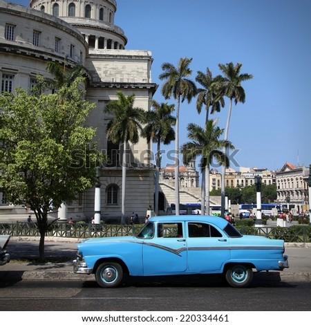 HAVANA, CUBA - FEBRUARY 26, 2011: Classic American car in the street in Havana, Cuba. Cuba has one of the lowest car-per-capita rates (38 per 1000 people in 2008). - stock photo