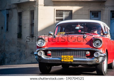 HAVANA, CUBA - FEBRUARY 18: classic American car on streets of Havana, where old vehicles become relic part of Cuban cities after Fidel Castor revolution in 1960's on February 18, 2011