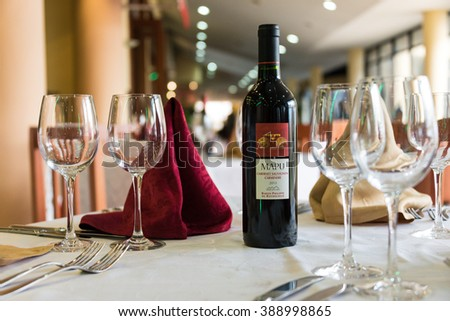 HAVANA,CUBA-FEBRUARY 8,2016:Hotel Comodoro interior details:Maipu wine in set table in the restaurant.The landmark belongs to Cubanacan S.A one of the first chains to start tourism in Cuba - stock photo
