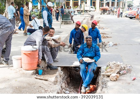 HAVANA,CUBA-FEBRUARY 9,2016:Old Havana reconstruction: workers having lunch and taking a break.Tourism has become the number one industry for Cuba,the government makes effort to improve infrastructure - stock photo