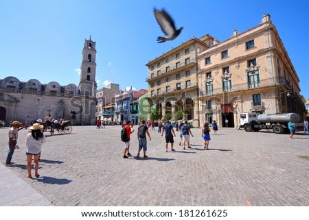 HAVANA, CUBA - FEBRUARY 27, 2011: People visit the Old Town in Havana, Cuba. Havana is the largest city in Cuba and its Old Town is a UNESCO World Heritage Site. - stock photo