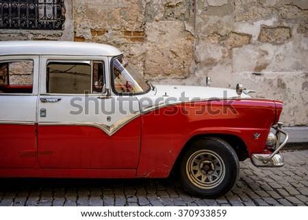 Havana, Cuba - Januar 5, 2016: A classic red and white american car in Old Havana, Cuba - stock photo