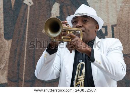 HAVANA, CUBA - JANUARY 8, 2015 : Black cuban musician playing the trumpet - stock photo