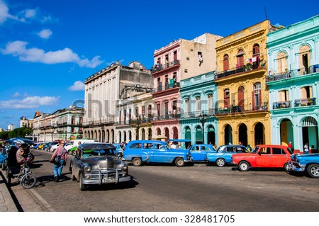 HAVANA, CUBA - JANUARY 1, 2014: Chevrolet cars are used as taxi on the street of Old Havana, Havana, Cuba. This is the most common transportation in the capital city.