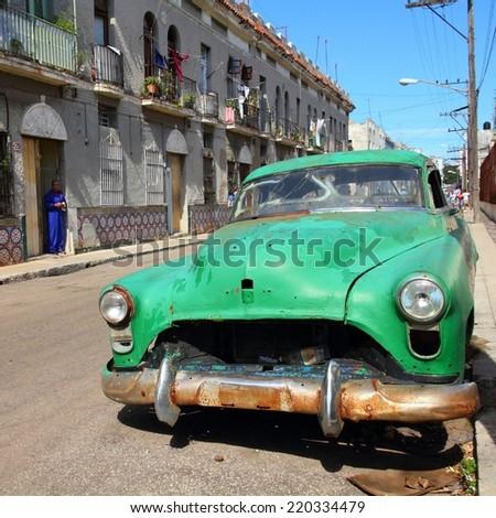 HAVANA, CUBA - JANUARY 30, 2011: Classic American car in the street in Havana, Cuba. Cuba has one of the lowest car-per-capita rates (38 per 1000 people in 2008). - stock photo