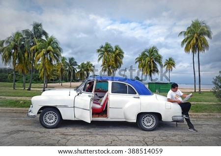 Havana, CUBA - JANUARY 14, 2016: Havana old classic American car on beach near Havana. Havana,CUBA. Cuba - Havana. Cuba cars in Havana. Cuba,Cuba american classic car near the beach. Editorial photo. - stock photo