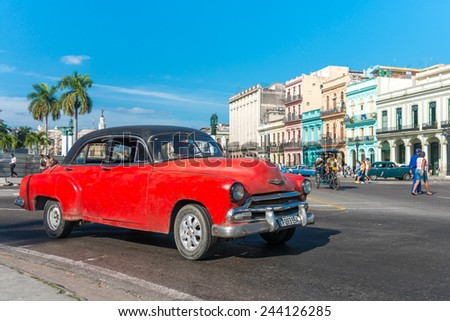 HAVANA, CUBA - JANUARY 8, 2015 : Old american car on a beautiful sunny day in Old Havana - stock photo