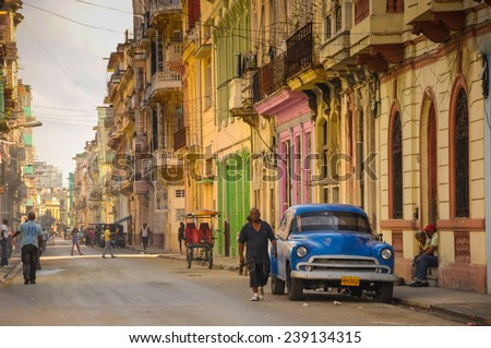 Havana, CUBA - JANUARY 20, 2013: Old classic American car park on street of Havana,CUBA. Old American cars are iconic sight of Cuba street. - stock photo