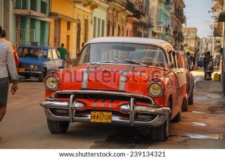 Havana, CUBA - JANUARY 20, 2013: Old classic American car park on street of Havana,CUBA. Old American cars are iconic sight of Cuba street. - stock photo