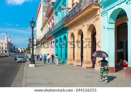 HAVANA, CUBA - JANUARY 8, 2015 : Street scene with colorful buildings on a sunny day in Old Havana - stock photo